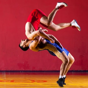 custom wrestling uniforms two guys training