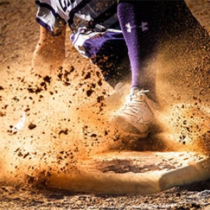 custom baseball uniforms player sliding into base