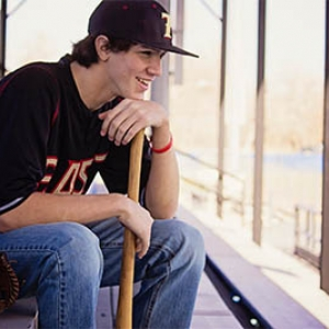 custom youth baseball uniforms teenager in stands smiling