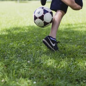 custom youth soccer uniforms kicking ball